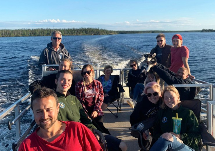 Playing hard! One of the benefits of being isolated in a small group in northern Manitoba. Pontoon boat ride!