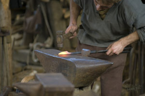Blacksmith uses medieval style of anvil in his craft