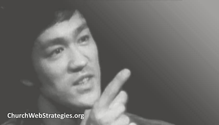 close-up photo of Bruce Lee talking