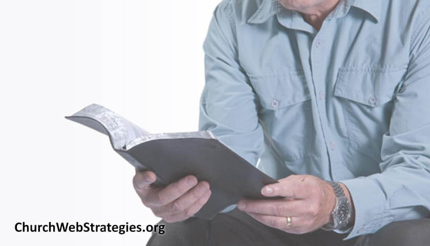 seated man reading Bible