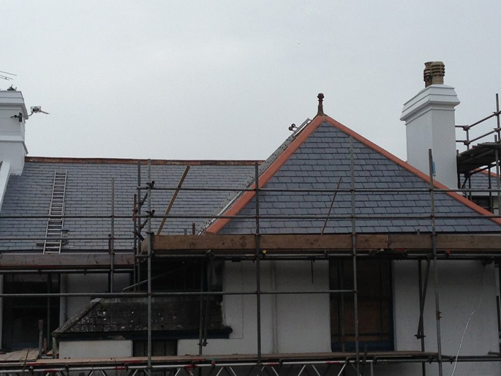Original ridge tiles were retained for character where possible