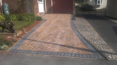 Block paved driveway completed.