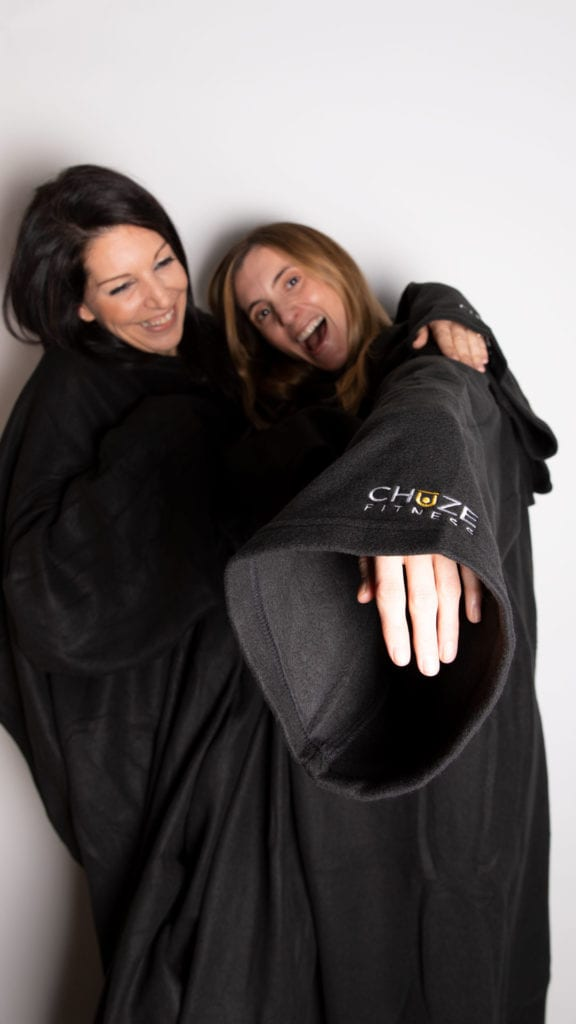 Team Members, Chrissy and Kinsey wearing our date night snuggie giveaways