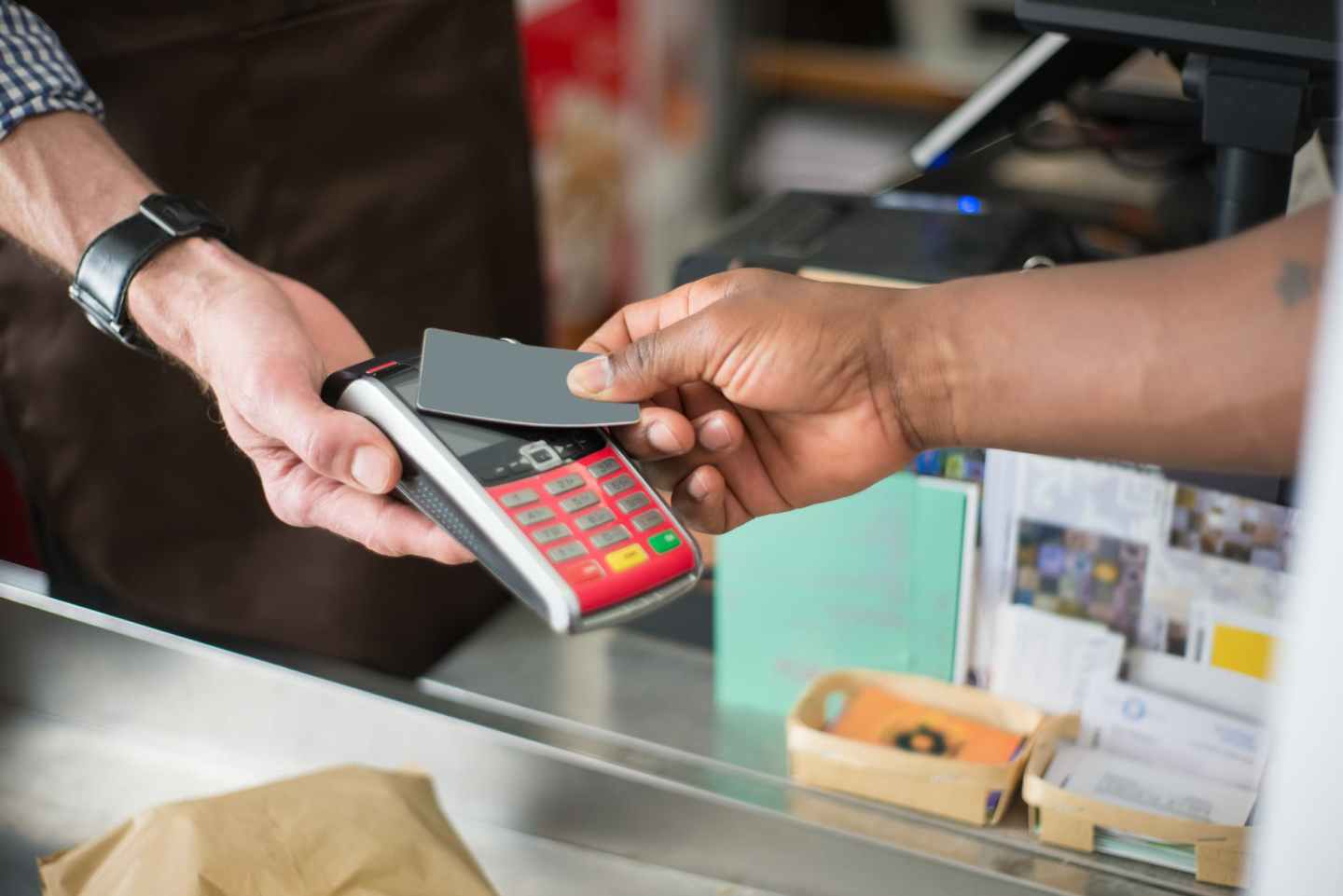 person paying using a bank card