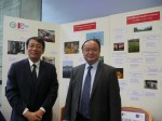 Senior embassy staff enjoy the Young Photographers' exhibition