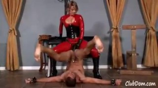Goddess Brianna in red latex fucks her male until he shakes