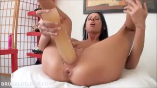 Hot brunette fucking her tight pussy with a huge dildo in HD