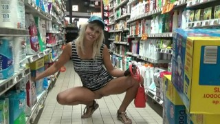 Blonde without panties flashing pussy in supermarket
