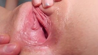 Licking her pink horny pussy