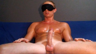 Young guy with blindfold masturbating and cumming on the sofa