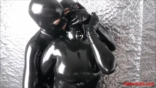Foreplay in total latex enclosure with hot fan #1