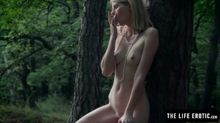 Skinny girl fucks herself hard in the forest