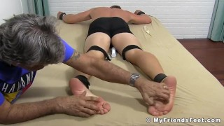 Bound hunk Kenny has his body and feet tickled by dom