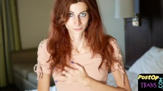 Cute redheaded ts chick toys her pussy