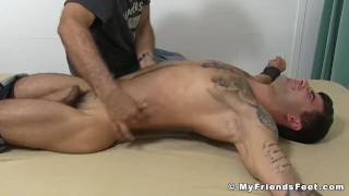 Bound tattooed hunk laughs his ass off while dom tickles him