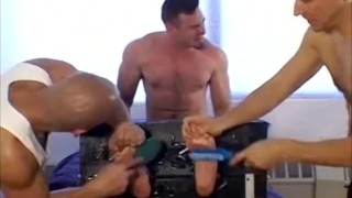 Restrained muscular hunk receives foot tickling in 3way