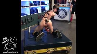 boy demonstrates big dildos at public event