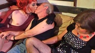 Pale redhead younger crossdresser sucking old mans cock