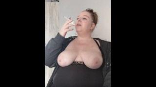 Smoking with big breasts out!