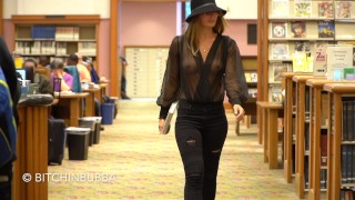Braless girl in the public library