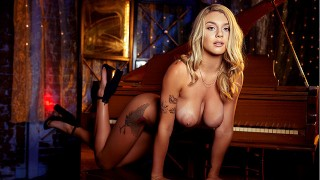 Busty natural pornstar Gabbie Carter masturbates by piano