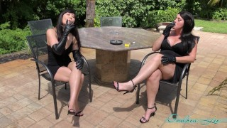 Asian and Friend Smoking in Leather Gloves Outside