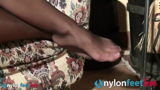 Brunette foot massage in black pantyhose