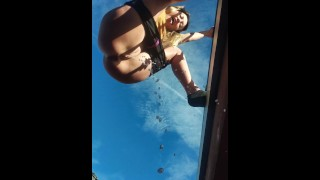 Teen girl peeing & hanging off side of two story balcony. DANGEROUS! RISKY!