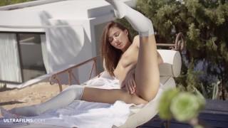 ULTRAFILMS Michaela Isizzu in a beautiful slow striptease and pussy spread.