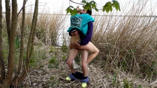 Outdoor strip and fuck by the lake with big cumshot in her face