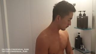 Muscular gay Japanese porn star Hiroya strips naked for erotic shower