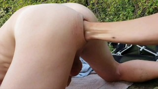Gay twink gets fisted outdoors showing rose