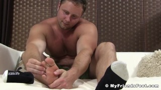 Muscular gay dude teases while playing with his soft feet