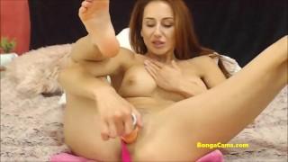 Redhead BongaCams beauty slowly brings herself to an orgasm