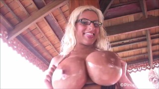 Busty Taylor Stevens oils up her beautiful tan tits for you
