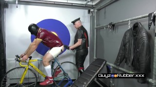 RUBBER EXERCISE. GUY IN RUBBER Exercising AND FANTASISING ABOUT A LEATHER DOM AS HIS TRAINER