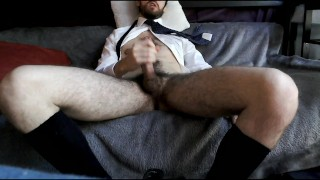 Young guy jerks off and cums on his chest after work