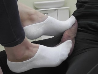 My feet in white socks play with the cock and balls