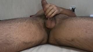 A hairy Japanese boy finishes masturbating while showing the back streaks