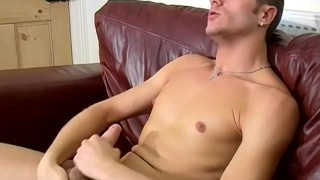 British lad Aiden jerks off his throbbing cock while moaning