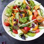 Bowl of Cucumber Tomato Salad with Scallions and Herbs