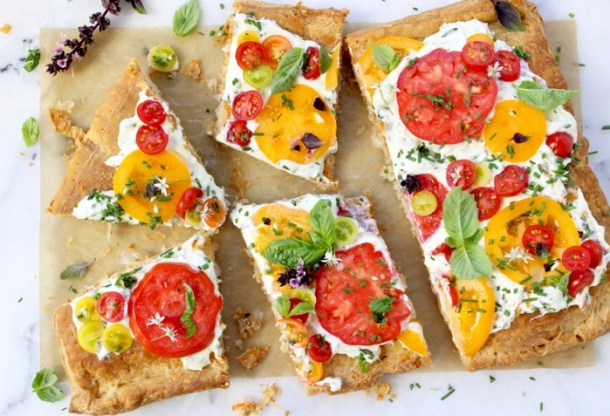 Sliced Tomato Tart Recipe with Goat Cheese, Puff Pastry and Herbs on a Marble Board