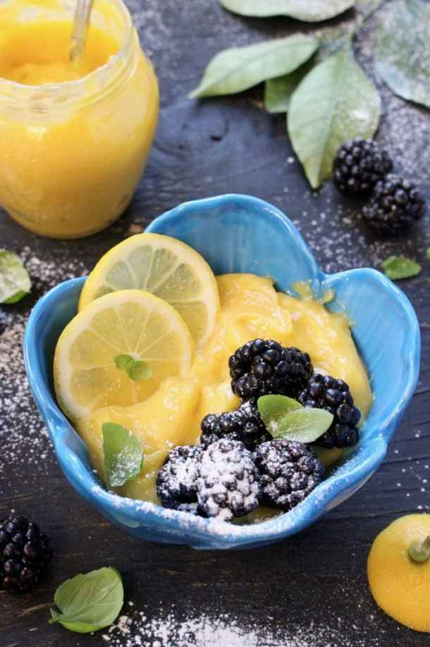 Easy Lemon Curd Filling topped with Blackberries, Basil and Powdered Sugar