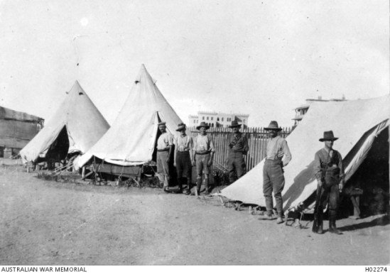AWM Photo H02274 SUEZ CANAL AREA, EGYPT. C. 1915. SIX AUSTRALIAN SOLDIERS OUTSIDE TENTS ON THE EDGE OF MOASCAR CAMP. (DONOR A.M. MEENAH)