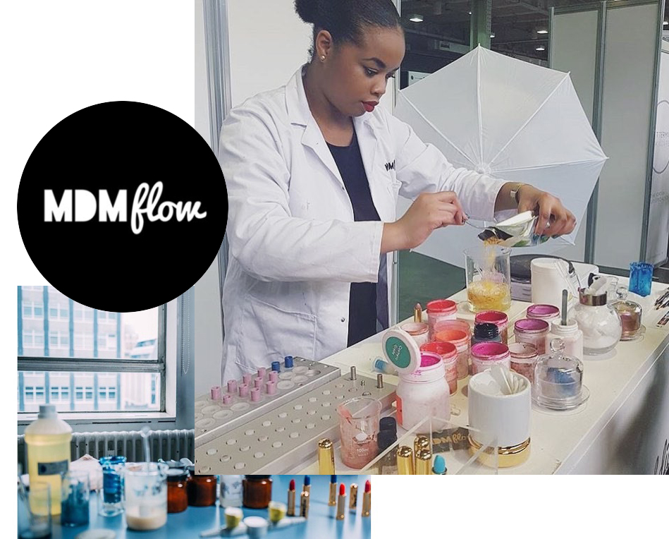 Florence Adepoju in her Lab Formulating mdm flow makeup and lipstick