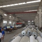Rolls of raw material, and behind another lamination process