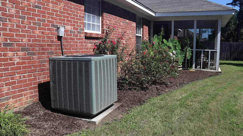 AC outer in the lawn.