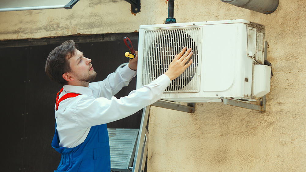 HVAC technician checking the AC.