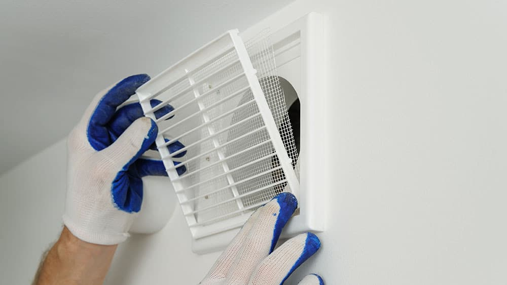 Man closing the vent.