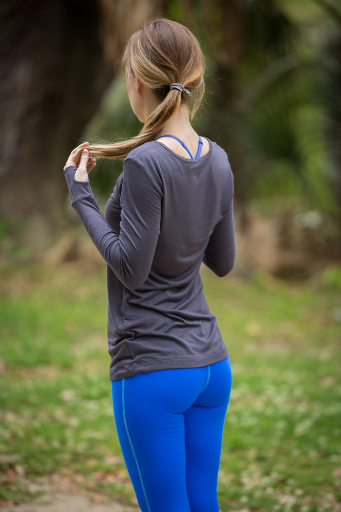 Woman in Blue Leggings and Gray Top for Workout
